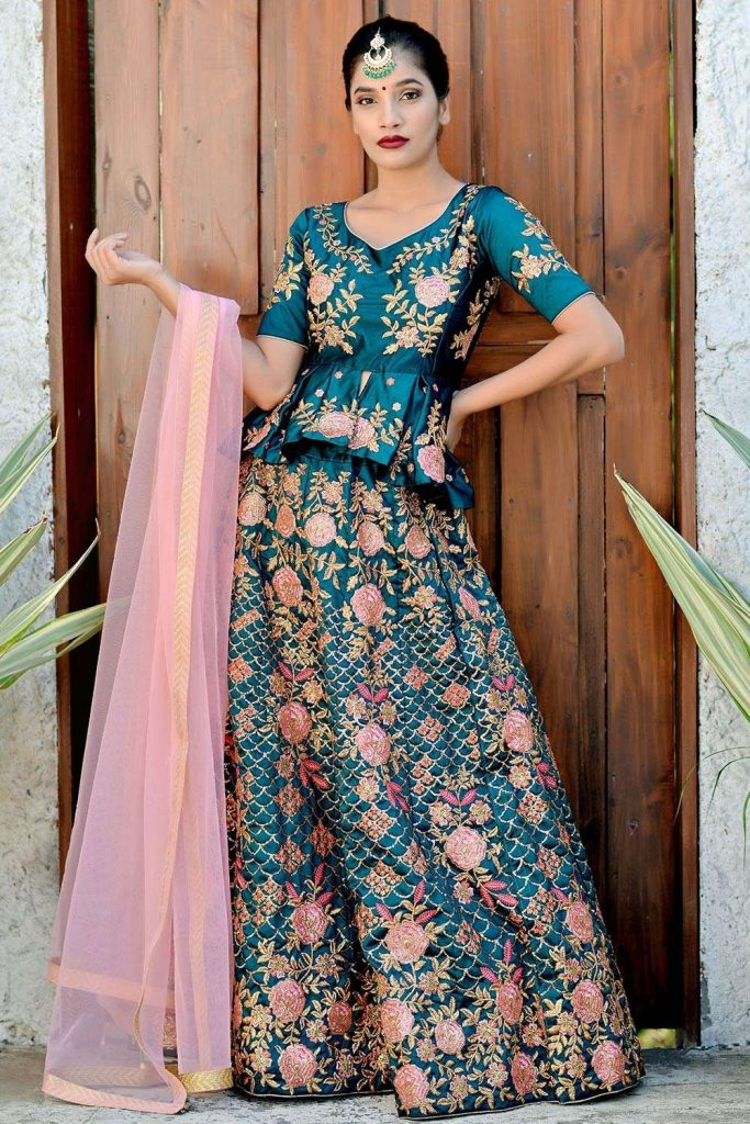 Teal Green peplum top and floral embroidered lehenga choli at Shopkund